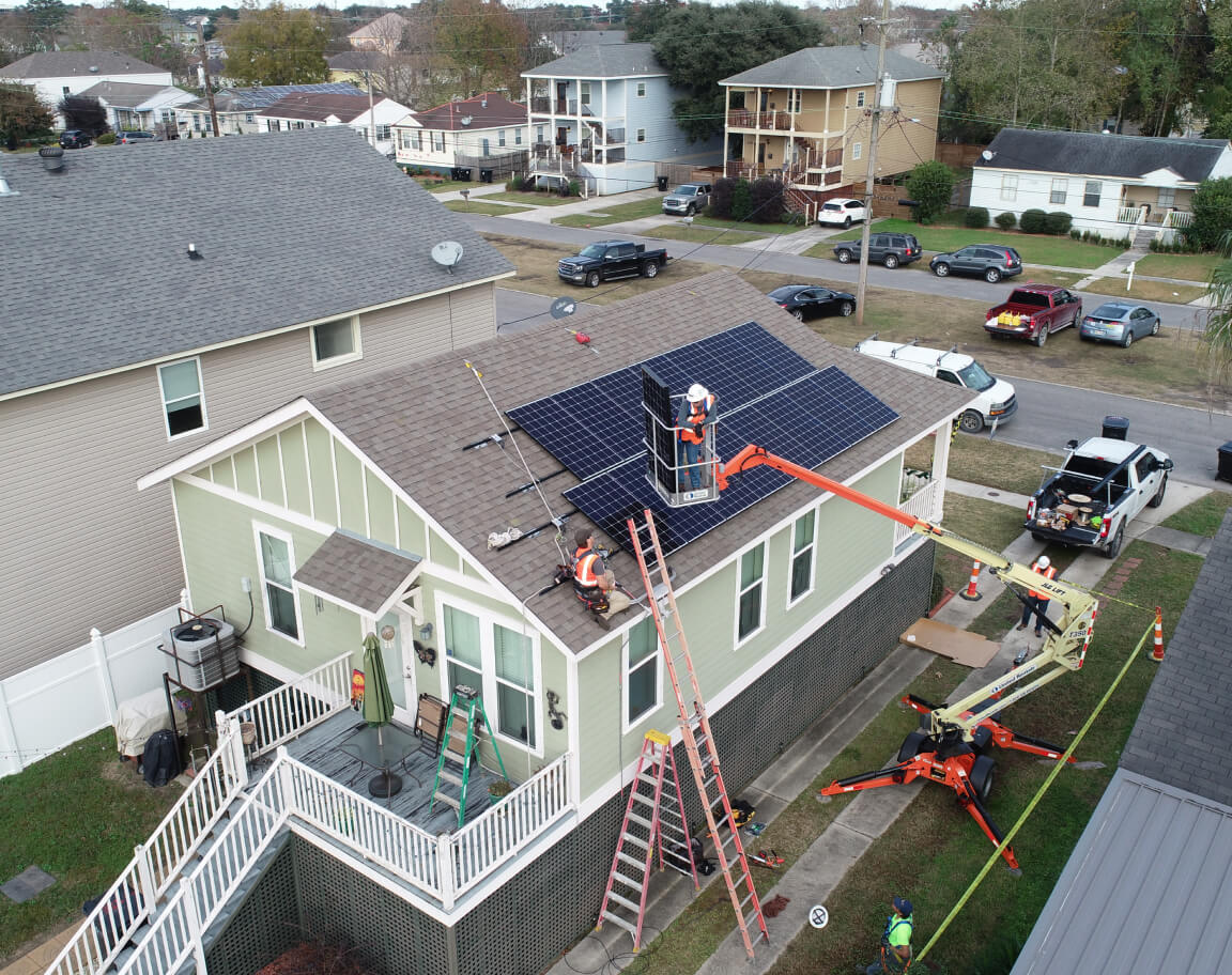 Construction of roof top solar on New Orleans residential home.