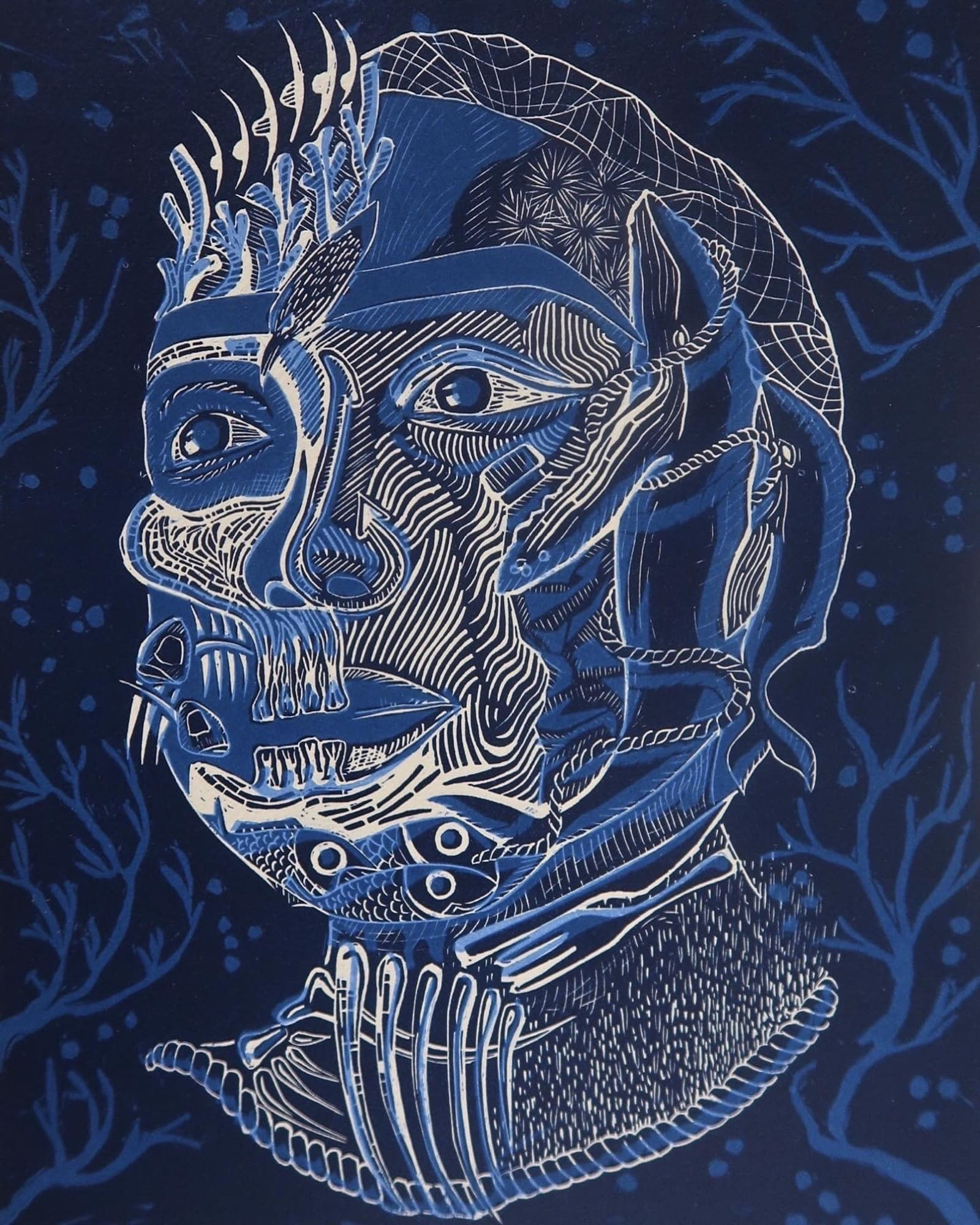 Linocut of a face in blue and white, a work by Chayna Yoshida