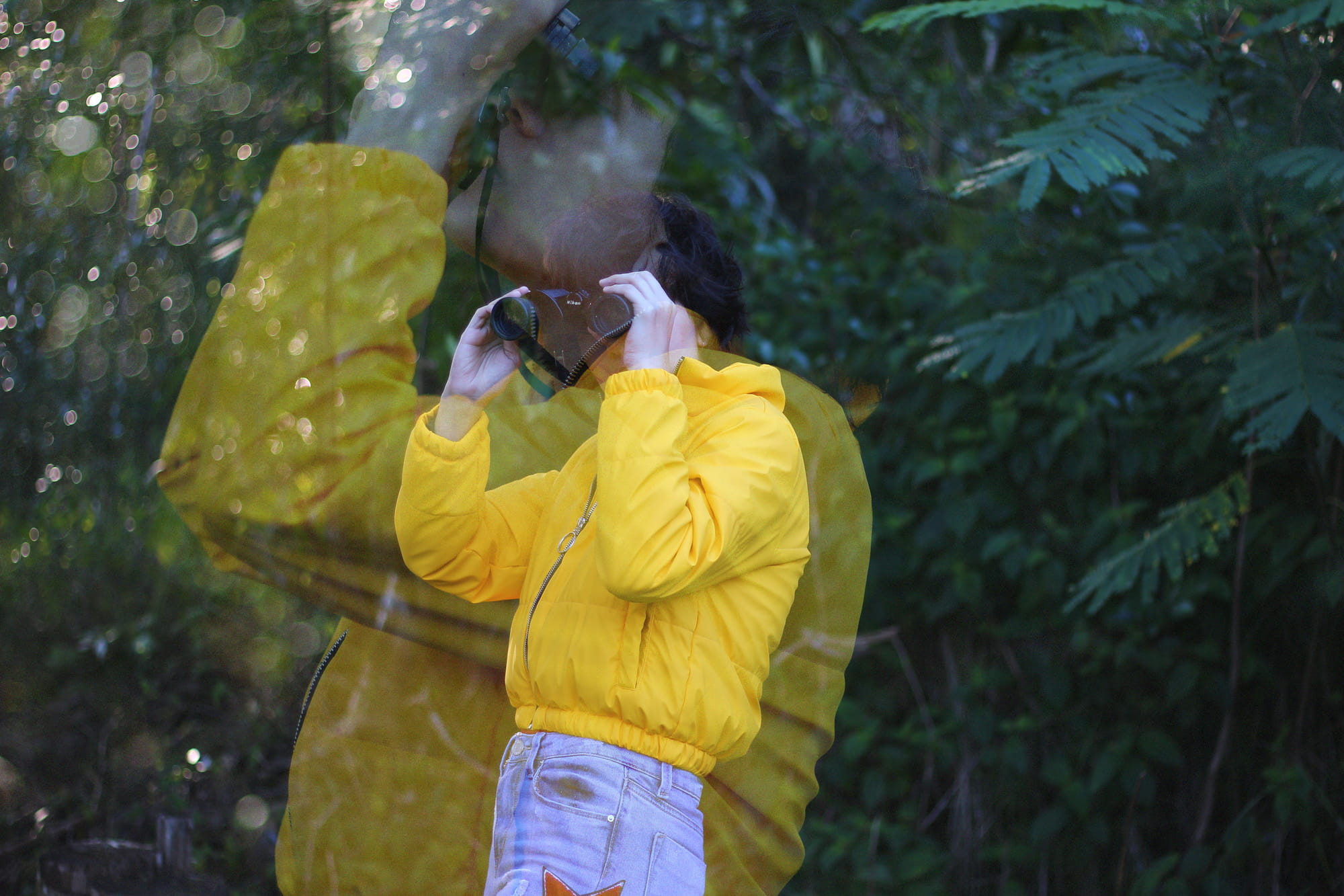 Portrait of a person in a yellow jacket by Sky Crosby