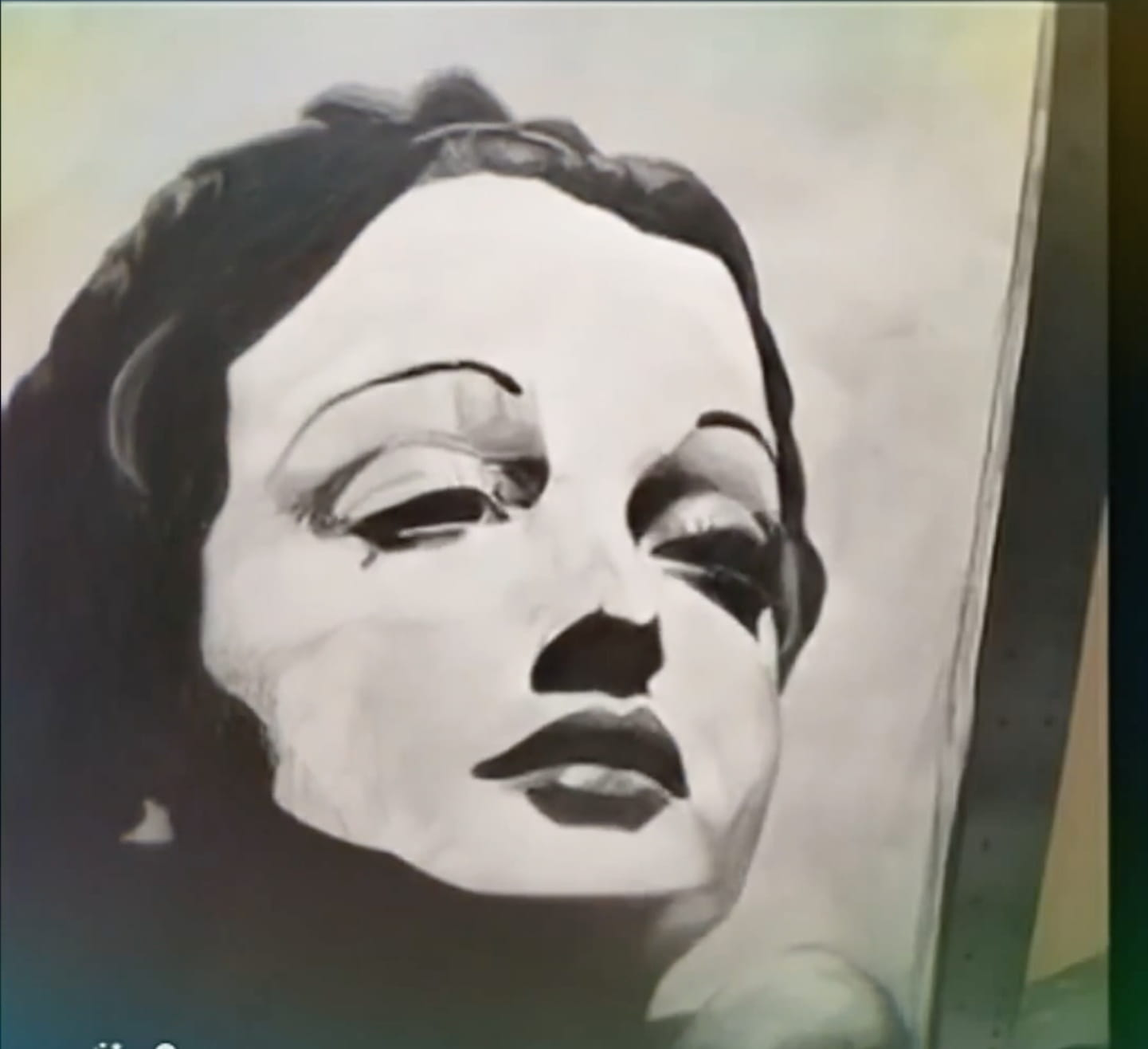 A still image from the video, a painting of a woman by Nowel Lucas