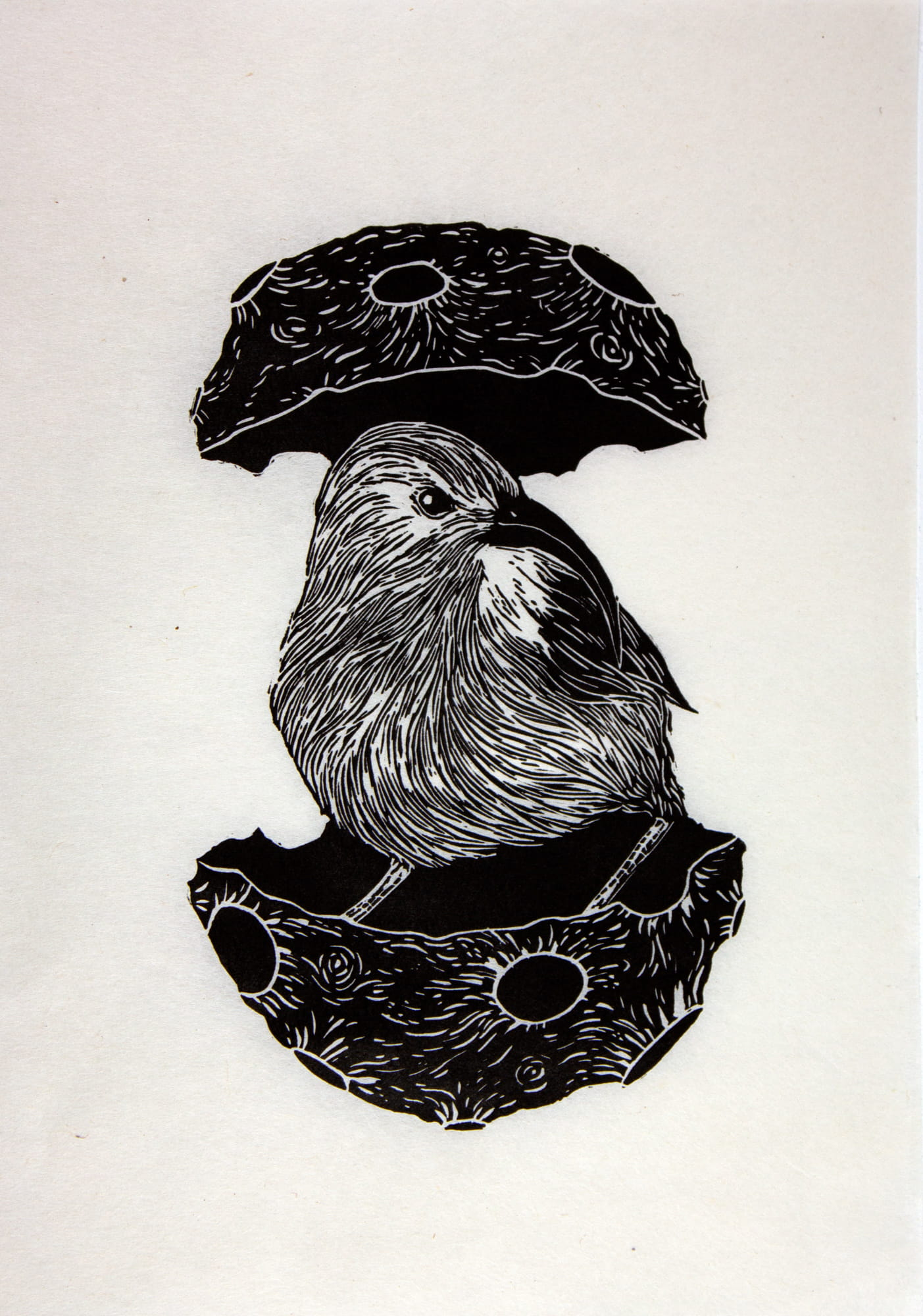Linocut of a bird hatching from an egg by Kawelina Cruz