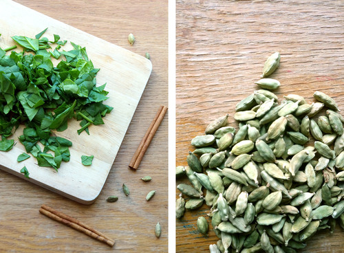 Dual image, cutting board covered in chopped herbs on one side, pile of green cardamom pods on the other