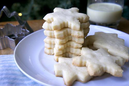 A stack of snowflake shaped sugar cookies