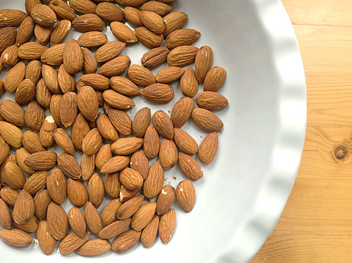 A closeup shot of a bowl of almonds