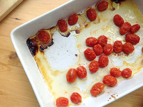 roasted cherry tomatoes in a baking dish