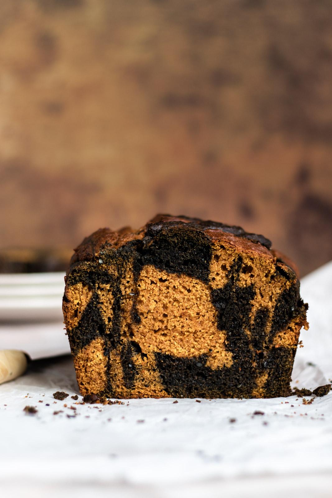 Crumb shot side-view of a loaf of black sesame swirl pumpkin bread