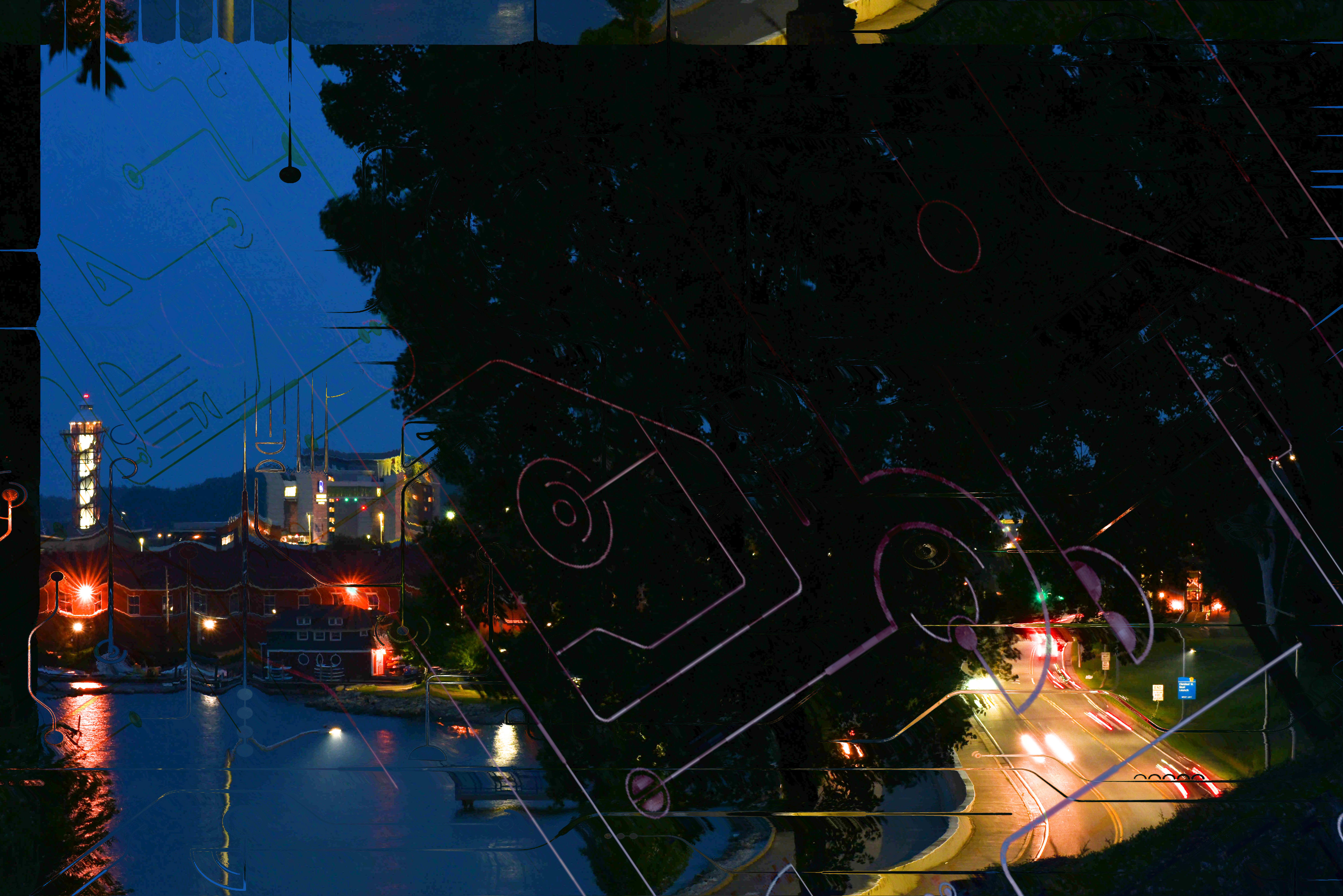 Image is a photo that was edited on a computer. The photo is a cityscape at night, featuring water, trees, buildings, a street, and lights. The photo is overlaid with thin lines that represent digital infrastructure in a city.