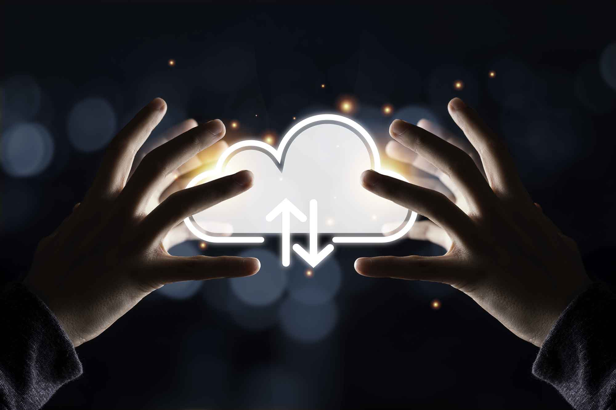 Picture of two people grabbing a cloud icon.