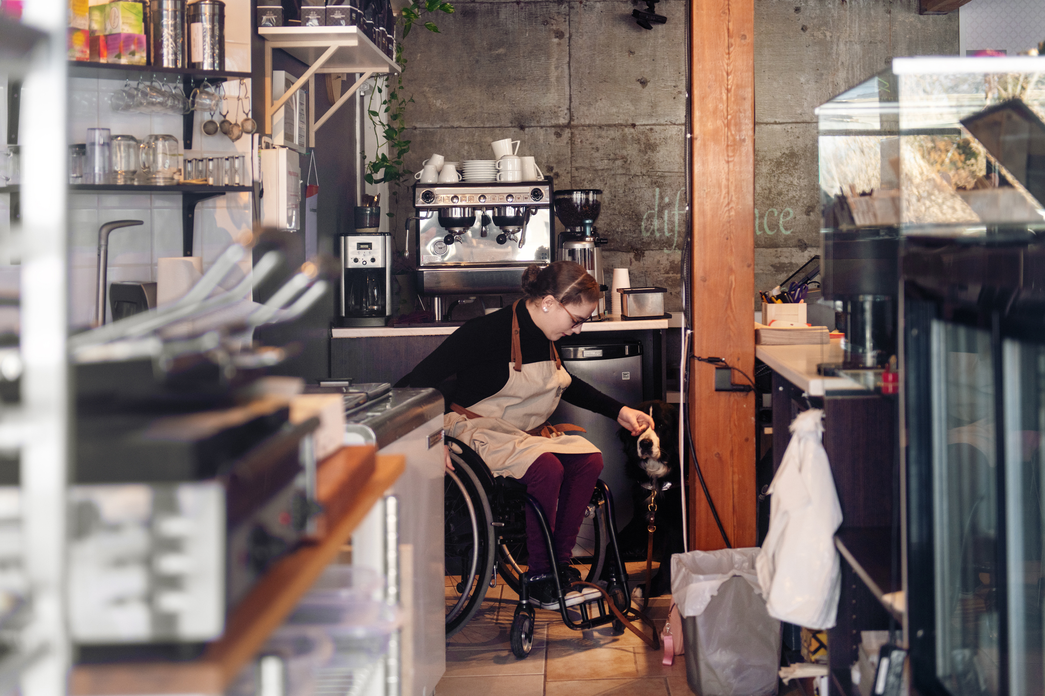Disabled woman working in bakery cafe