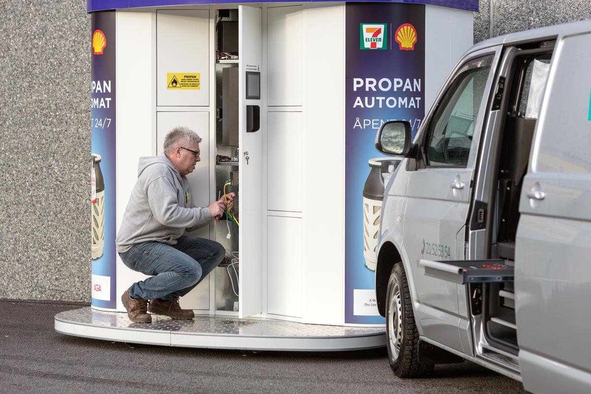 Vendanor service team working on propane vending machine