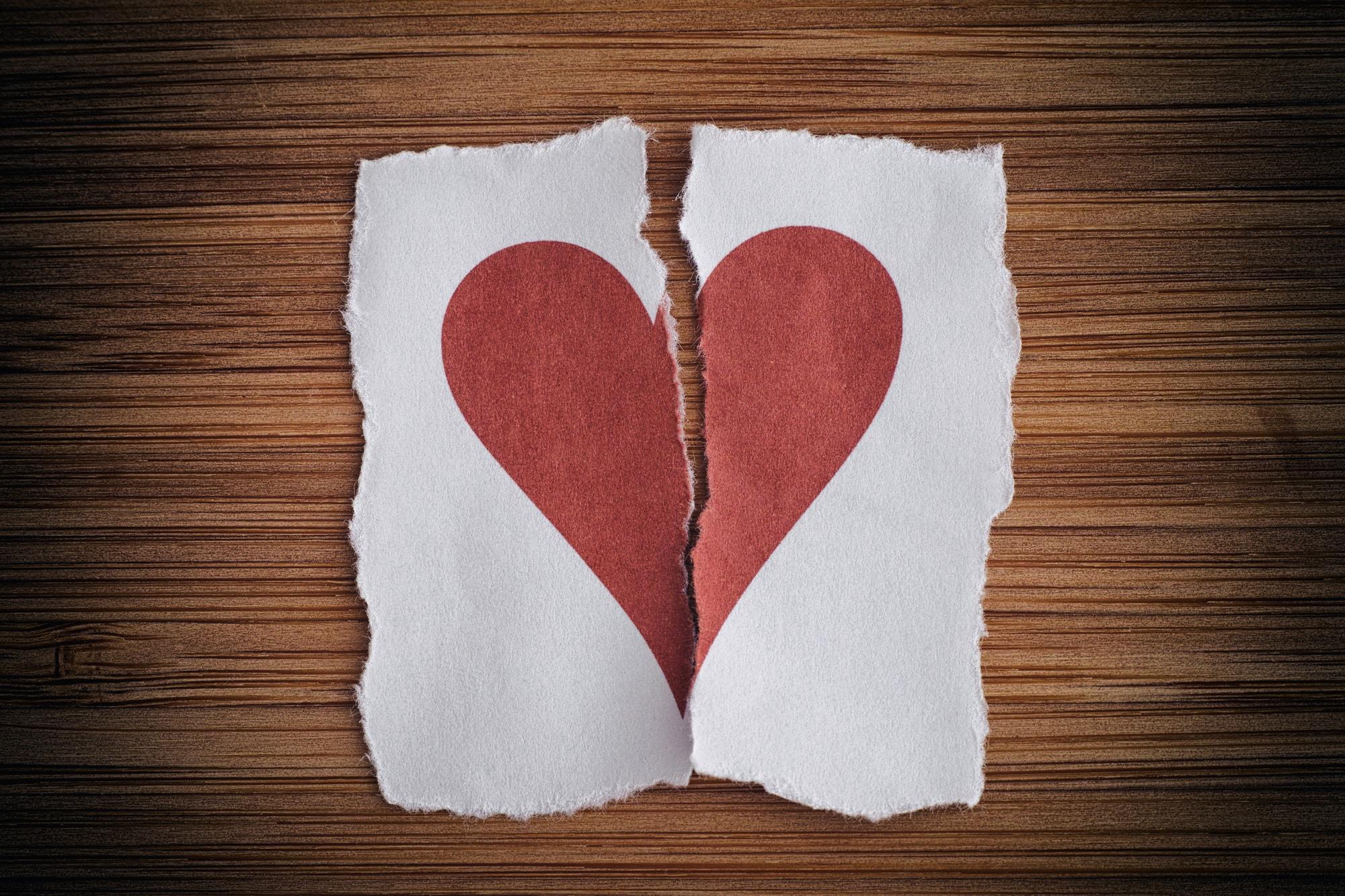 Divorce in June, paper heart ripped in half
