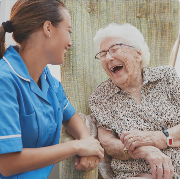 Carer and client laughing outside