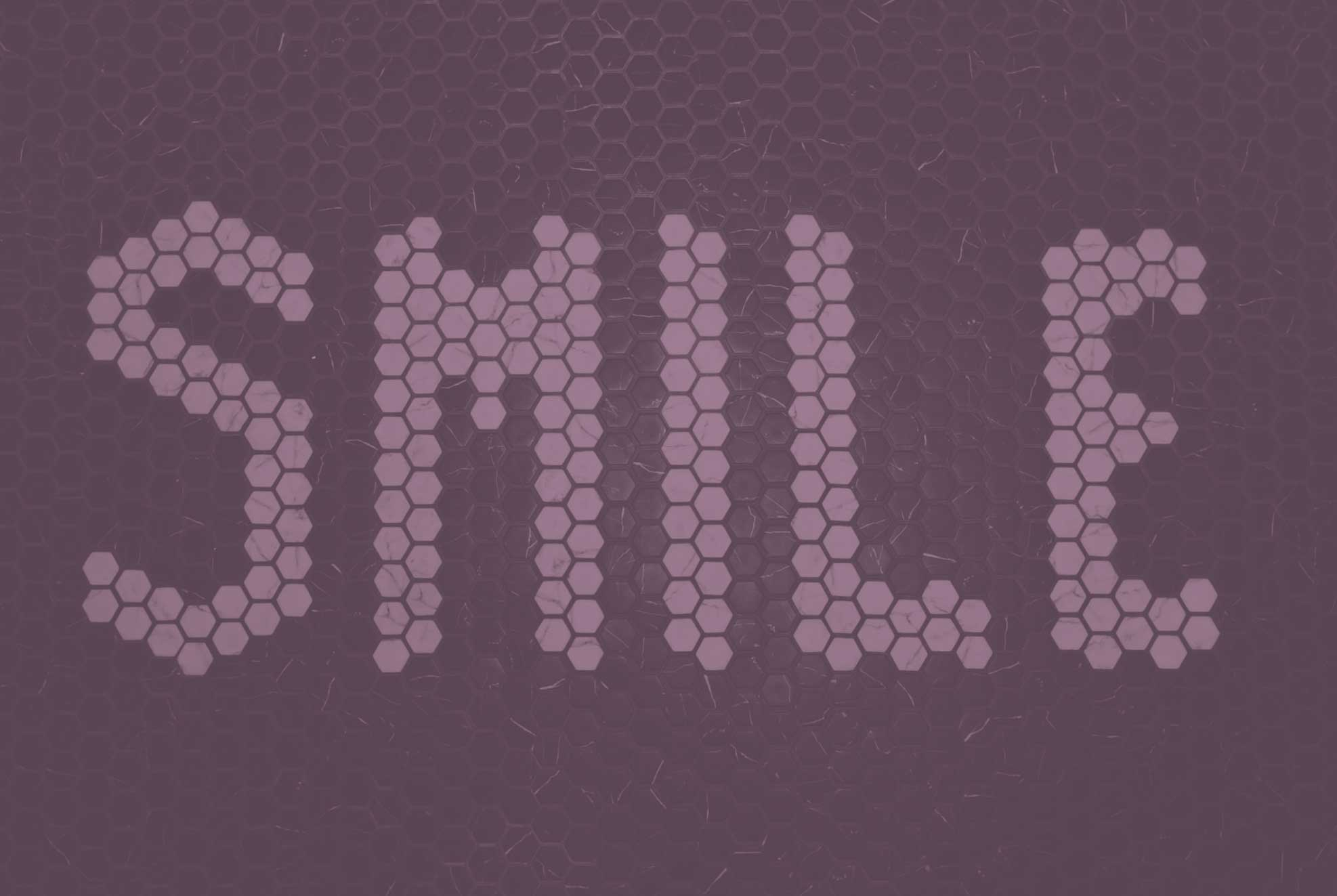 """A photo of a tile floor which spells out the word """"Smile"""""""