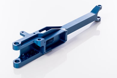 Precision machine structural component for robotics with a blue anodize finish