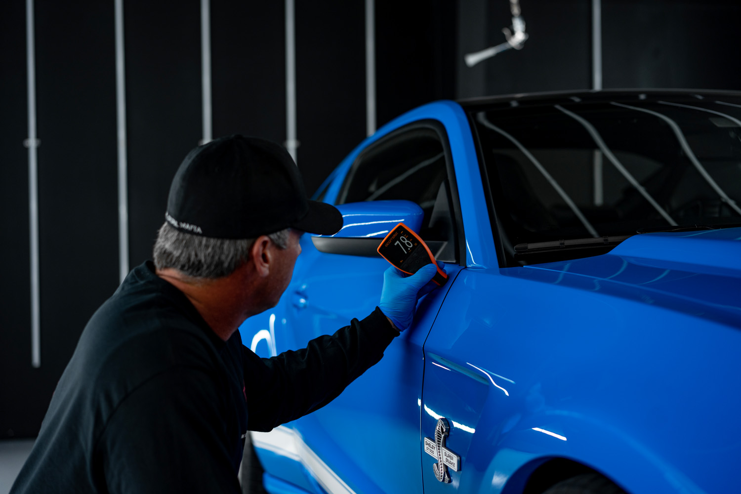 A member of the team checking a Mustang for quality