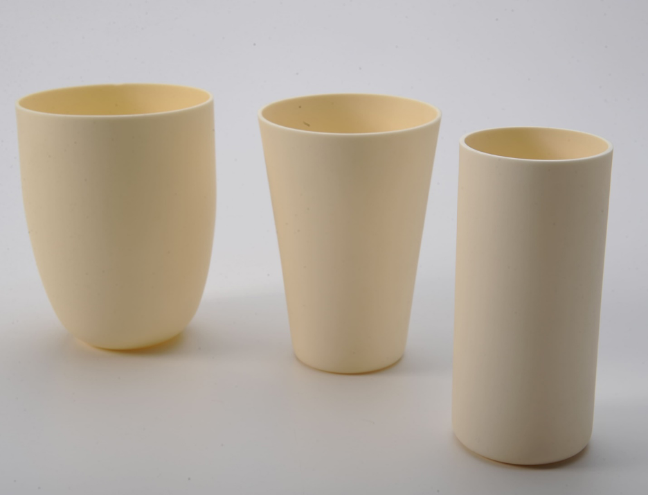 three pieces of high-purity alumina ceramic labware sitting on a white table