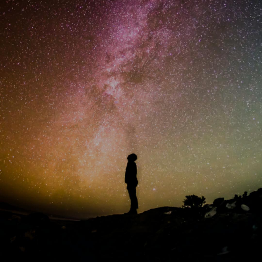 Man staring up at the stars