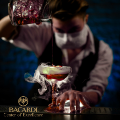Bartender mixing and pouring a drink