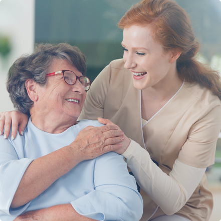 Carer and client laughing