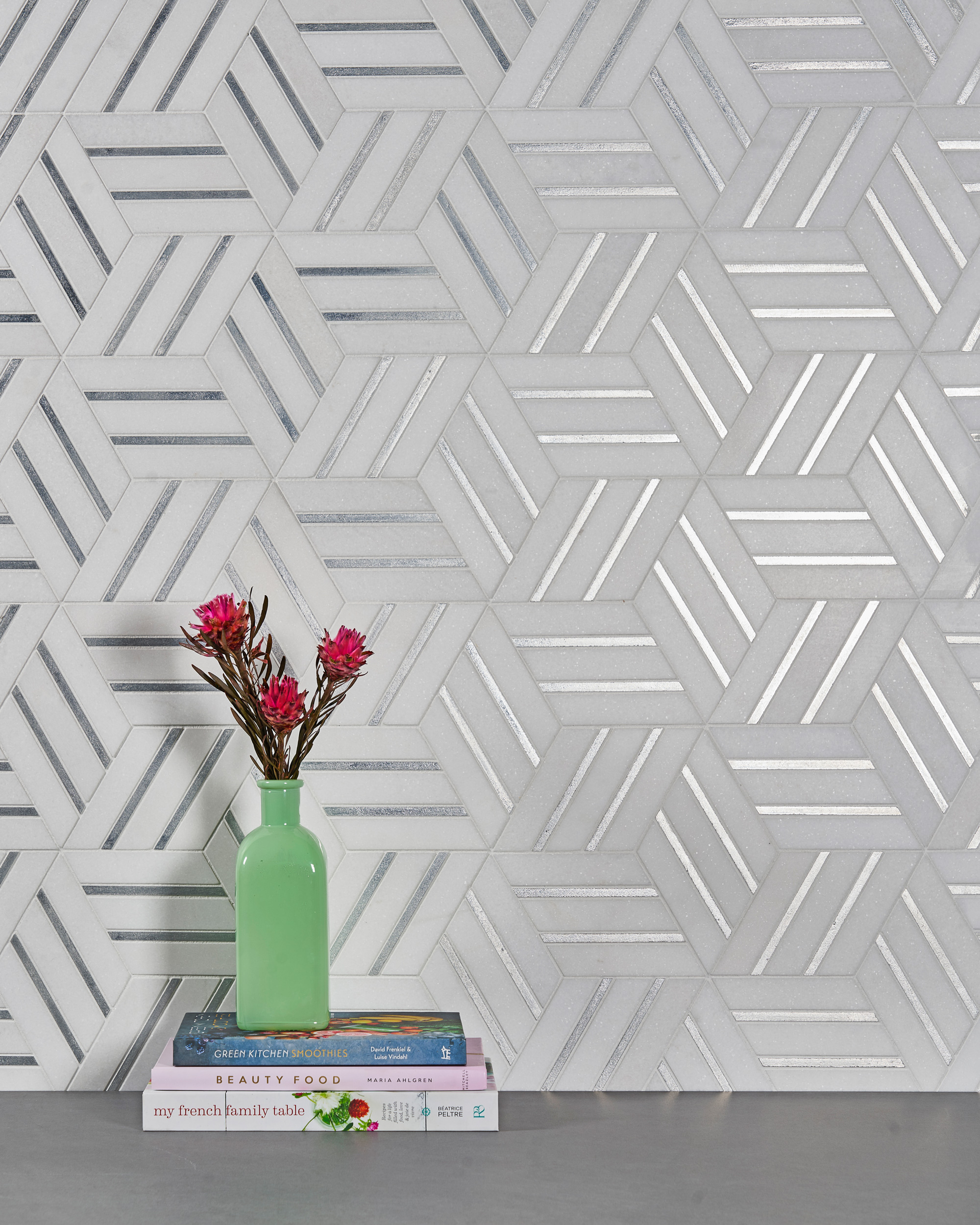 High-end tile featuring mostly marble mosaics and one-of-a kind designer collections.