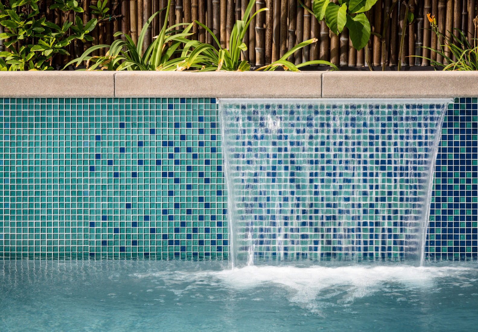 Handcrafted glass tile made from recycled bottles, great for pools or accent spaces.
