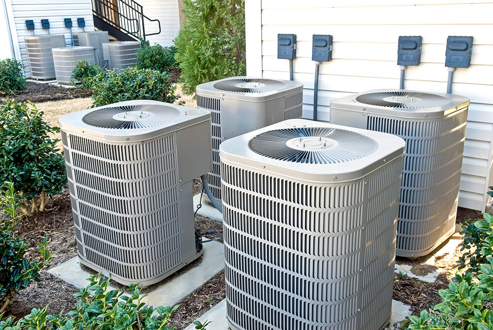 Photo of four exterior AC units