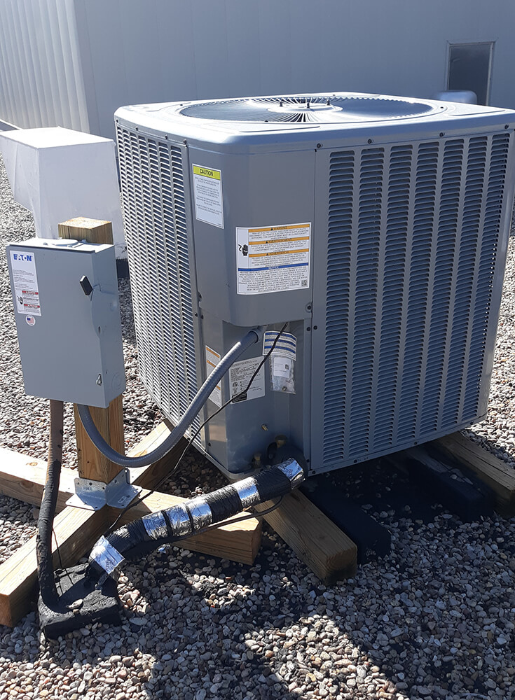 Photo of an AC unit on a roof