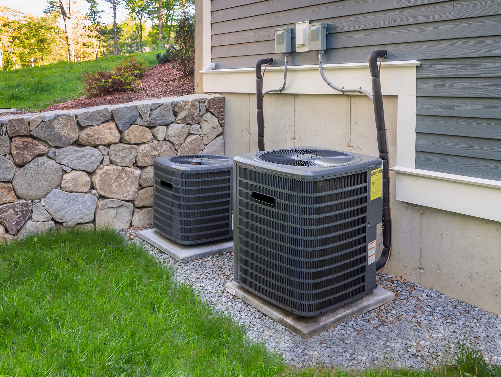 Photo of two AC units outside a beautiful house
