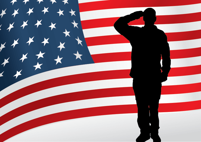 Man saluting silhouetted against an American flag