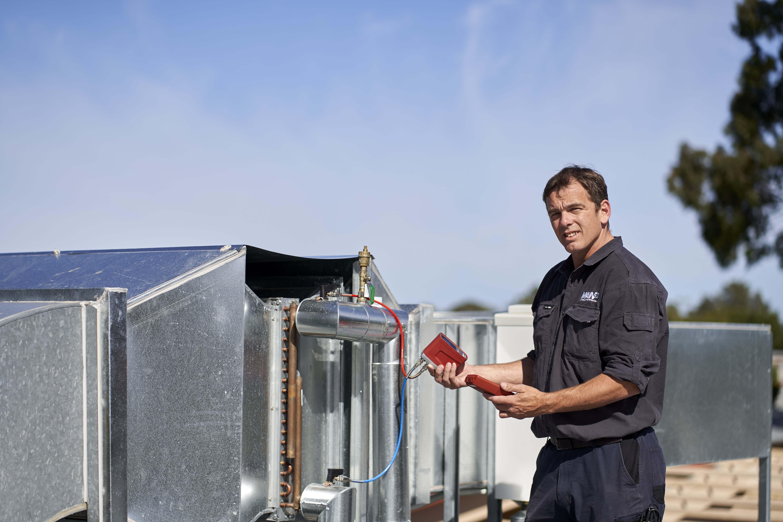 MAINair service repairer conducting preventative maintenance