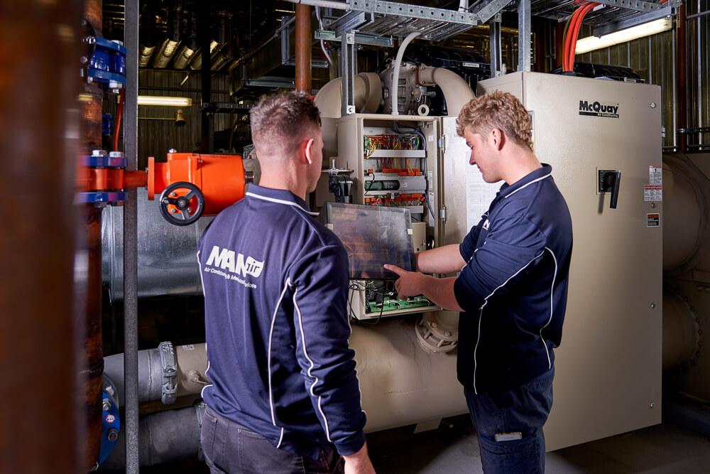 Two HVAC technicians inspect system at Flinders University, South Australia