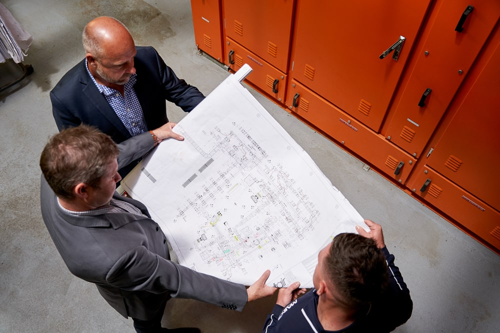 Team of experts review commercial HVAC commissioning and installation plan