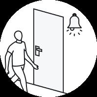 Men walking past a door and it rings