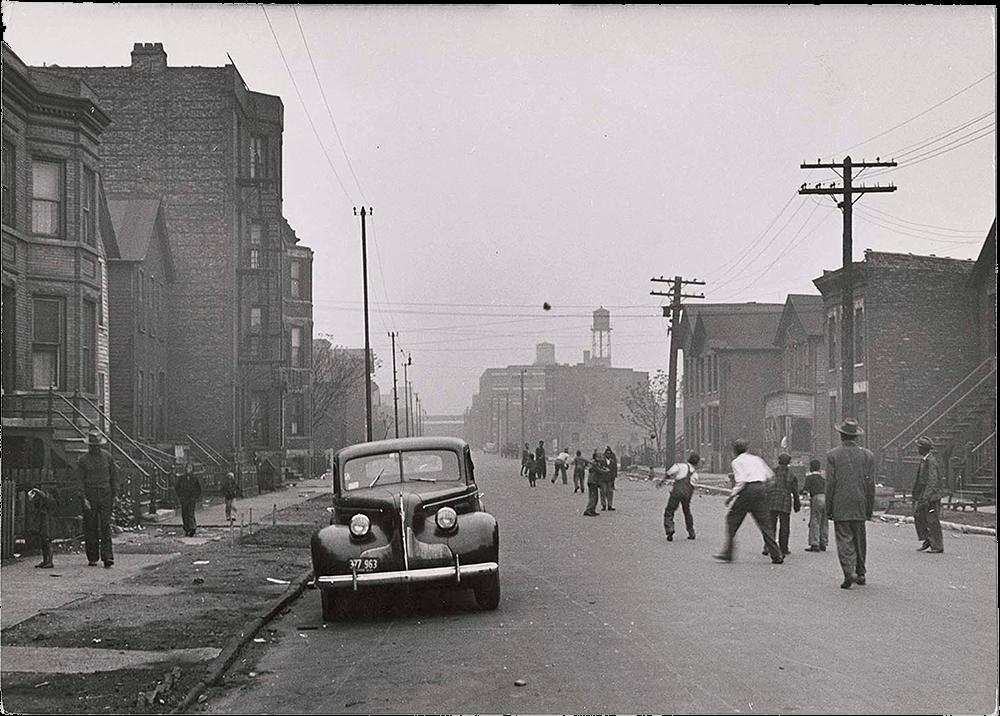 Children posing on a sidewalk in the slums of Chicago