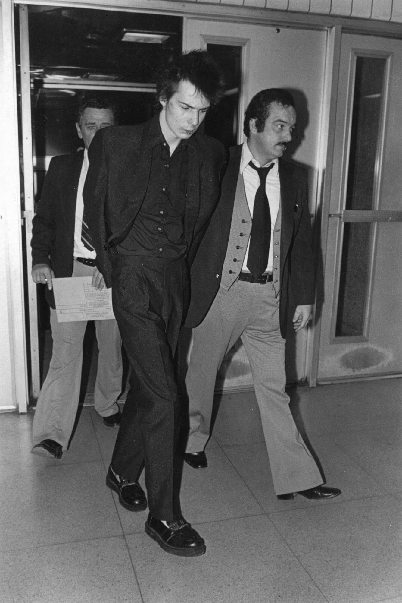 Sid Vicious Under Arrest for the Murder of Girlfriend Nancy Spungen outside the Chelsea Hotel, 1978