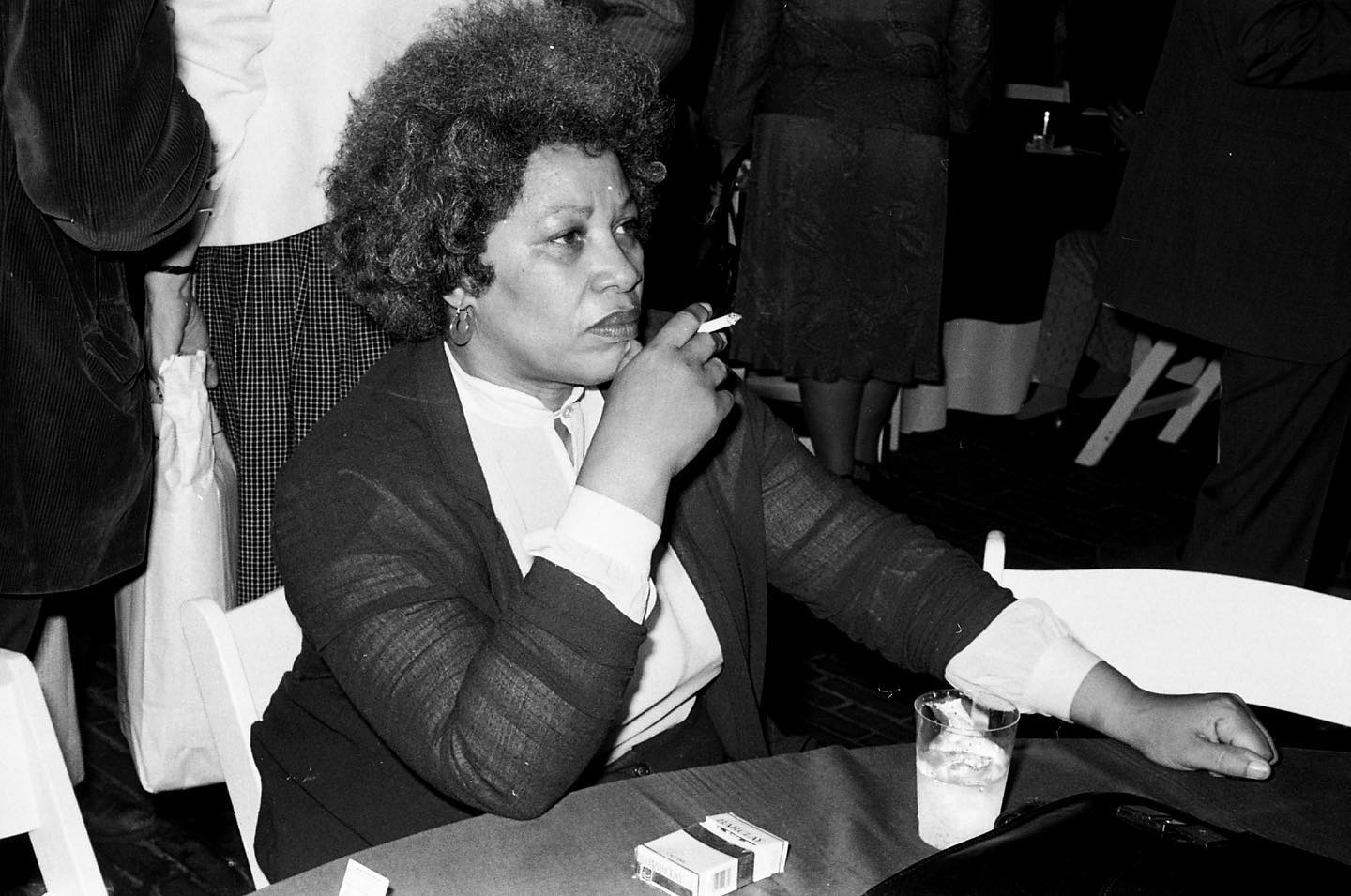 "#Onthisday in 1931, American author and professor Toni Morrison was born in Lorain, Ohio. In 1949, Morrison attended the historically Black college Howard University in Washington, DC, where she experience racially segregated buses and restaurants for the first time. In 1955, she went on to get her Master of Arts from Cornell, and began teaching shortly after. In 1965, Morrison became an editor for Random House in Syracuse, and was then transferred to the New York City offices, where she became the first black woman senior editor in the fiction department; her role allowed her to bring Black literature into the mainstream. Morrison began spending more time on developing her own writing and in 1970, her first book, ""The Bluest Eye,"" was published. In 1975, ""Sula,"" her second book, was published and was nominated for a National Book Award. She went on to write many books including ""Tar Baby"" and ""Song of Solomon,"" which won a National Book Critics Award. In 1987, Morrison published another book called ""Beloved,"" which developed into a trilogy, and ultimately won her a Pulitzer Prize for Fiction and the Anisfieled-Wolf Book Award. In 1993, she was awarded the Nobel Prize in Literature and in 2012, Morrison was honored with the Presidential Medal of Freedom by Barack Obama. Her novels address aspects of racism that were often disregarded in mainstream literature, so her rise to becoming a well-known author opened the door for recognition of Black literature and the struggle in which Black folx endure. Her novels are now mainstays in both high school and college classrooms, and she will forever be remembered as a literary revolutionary who paved the way for future Black authors.   Toni Morrison is seen here at the 54th Academy Awards in 1982. #BlackHistoryMonth  📷©️Fred W. McDarrah/MUUS Collection  #muuscollection #blm #blacklivesmatter #blackhistory #tonimorrison #author #poet #sula #smoking #academyawards #photography #photographer #pictureoftheday #picoftheday #photooftheday #documentaryphotography #fredmcdarrah #nyc #newyorkcity #happybirthday #celebrateblackhistory #celebrateblackwomen #bookstagram #femalewriters #thebluesteye #literature #nobelprizewinner"