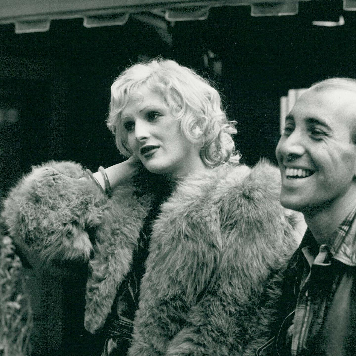 "In honor of #TransVisibiltyDay, as well as the last day of #WomensHistoryMonth, we're remembering legendary Warhol Superstar, Candy Darling!  Born in 1944 in Queens, NYC, Candy loved Hollywood glamour from the time she was small. Bullied intensely at school, she dropped out at 16, and at 17, she came out to her mother after being confronted for rumors of cross-dressing. Her mother later said ""I knew then... that I couldn't stop [her]... Candy was just too beautiful and talented.""  She initially adopted the name Hope Slattery in the early 60s, as she began frequenting gay bars in Manhattan and visiting a doctor on 5th Avenue for hormone injections. She soon met Andy Warhol, who casted in his films after seeing her perform in a play that she had written and directed. From there, her fame grew - Candy starred in more theatre, including the original production of Tennessee Williams' ""Small Craft Warnings"", at the playwright's request. She also appeared in more independent and international films, including Klute with Jane Fonda (who you can learn about in our recent post).  Darling is even immortalized in music, mentioned by name in Lou Reed's classic ""Walk on the Wild Side"" and the Velvet Underground's ""Candy Says"".  In 1974, Candy died of lymphoma at age 29. Her funeral was attended by huge crowds of friends and celebrities. Neither the priest nor eulogizers made mention of her birth name.  So many trans stories involve painful trials and suffering - while Candy was no stranger to these, she lived her life boldly, beautifully, and authentically, surrounded by people who adored her. We wish the same for all our transgender brothers, sisters, and siblings ❤️  1) Candy Darling and Tom Eyan arrive at Obie Awards, shot by Fred McDarrah. May 8, 1972.  2) Candy sits on Dave Susskind's ""FreeTime"" TV program, shot by Fred McDarrah. December 7, 1970.  © Fred W. McDarrah/MUUS Collection"