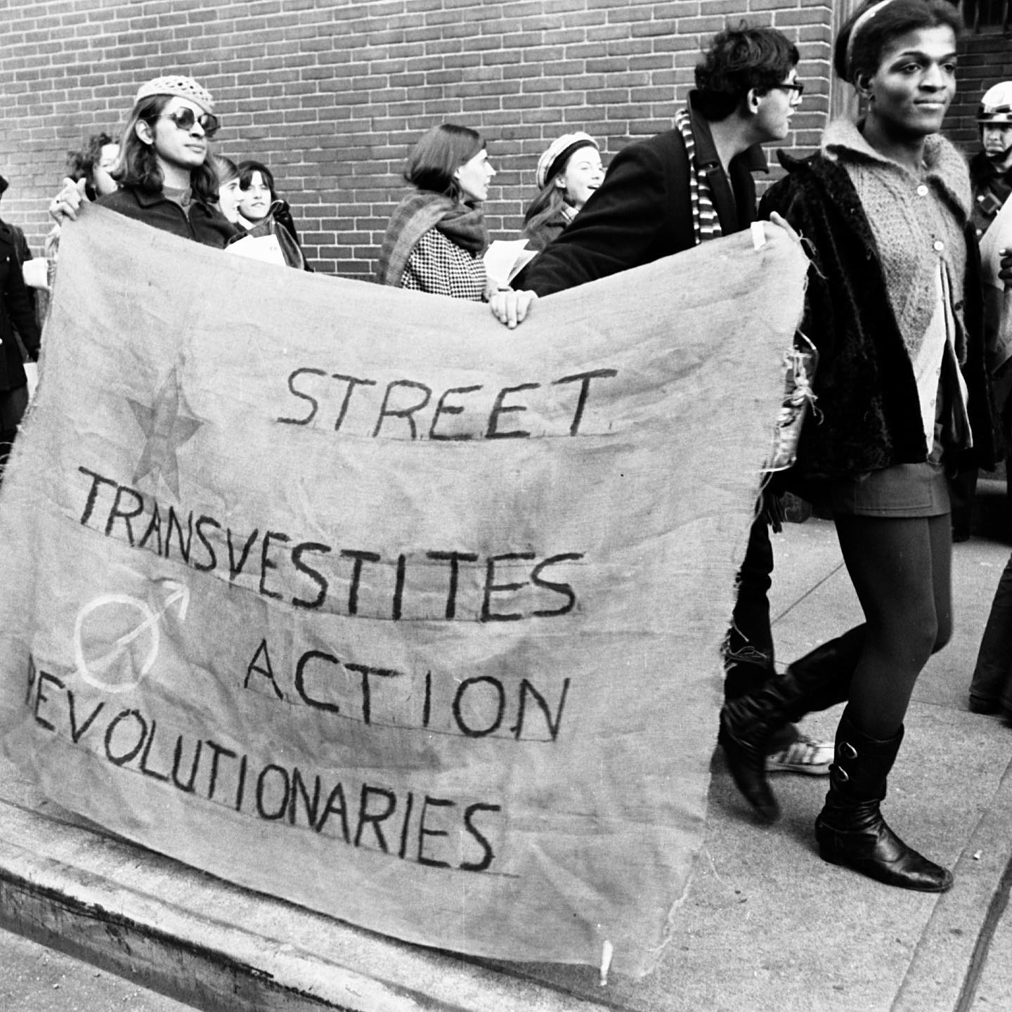 Happy Pride Month! 🌈 The next four weeks at this account will be dedicated to MUUS' images of LGBTQ pride and resistance. Today, we begin with a set of rare, never before seen images, of Marsha P. Johnson and Sylvia Rivera marching with a banner for their organization S.T.A.R., Street Transvestite Action Revolutionaries.  Throughout past decades, LGBTQ people have overcome huge hurdles of discrimination and violence. Same-sex couples can now be married in the US, openly LGBTQ individuals hold political offices, and LGBTQ storylines are no longer illegal or taboo in popular media.  However, there are still many hurdles to be overcome. According to a study by the Center for American Progress published in October, more than 1 in 3 LGBTQ Americans faced discrimination of some kind in the past year. For transgender Americans, the number jumps to 3 in 5. Further, 33 states have introduced over a hundred bills to curb the rights of trans people this year - from exclusion from school athletics, to an outlawing of transgender youth receiving gender-affirming healthcare (which significanlty helps to lower rates of depression and suicide). This slew of anti-trans legislation has made 2021 one of the worst so far for trans youth, who - without acceptance and proper support - are already one of the most vulnerable populations to homelessness, interpersonal violence, and suicide. Thus, we feel it to be our duty to share the history of LGBT people during Pride month, helping to shine a light on both the struggles and joys of this ongoing fight for self-determination and freedom.