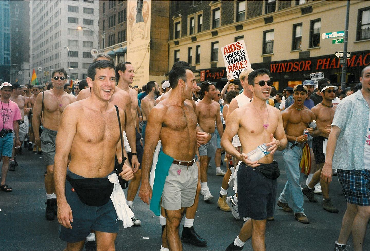 """Here, participants march down 6th Avenue during a #PrideParade in 1994, with a sign that reads """"AIDS: WHERE IS YOUR RAGE? ACT UP"""" This is one of the slogans of the activist group, ACT UP (AIDS Coalition Group to Unleash Power).  Perhaps one of the most well known AIDS advocacy groups, they describe themselves as such: """"ACT UP is a diverse, non-partisan group of individuals, united in anger and committed to direct action to end the AIDS crisis. We meet with government officials, we distribute the latest medical information, we protest and demonstrate. We are not silent.    ACT UP was formed in response to social neglect, government negligence and the complacency of the medical establishment during the 1980s. Soon it found itself needing to fight corporate greed, lack of solidarity and various forms of stigma and discrimination at home and abroad. While ACT UP has an incredible history, HIV/AIDS is not history. HIV/AIDS is very much with us. And we call on you to join our fight to end AIDS.""""  ACT UP was founded in March 1987, when powerhouse activist and writer Larry Kramer gave a speech at the Lesbian and Gay Community Services Center in NYC. According to """"AIDS Demographics"""" by Douglas Crimp, Kramer posed the question, """"Do we want to start a new organization devoted solely to political action?"""" To the enthusiasm of his audience, a meeting to form such an organization was arranged. Two days later, 300 people gathered to form @actupny.  Though Kramer passed away last summer at age 84, his legacy lives on through his written works and through the ongoing work of ACT UP."""