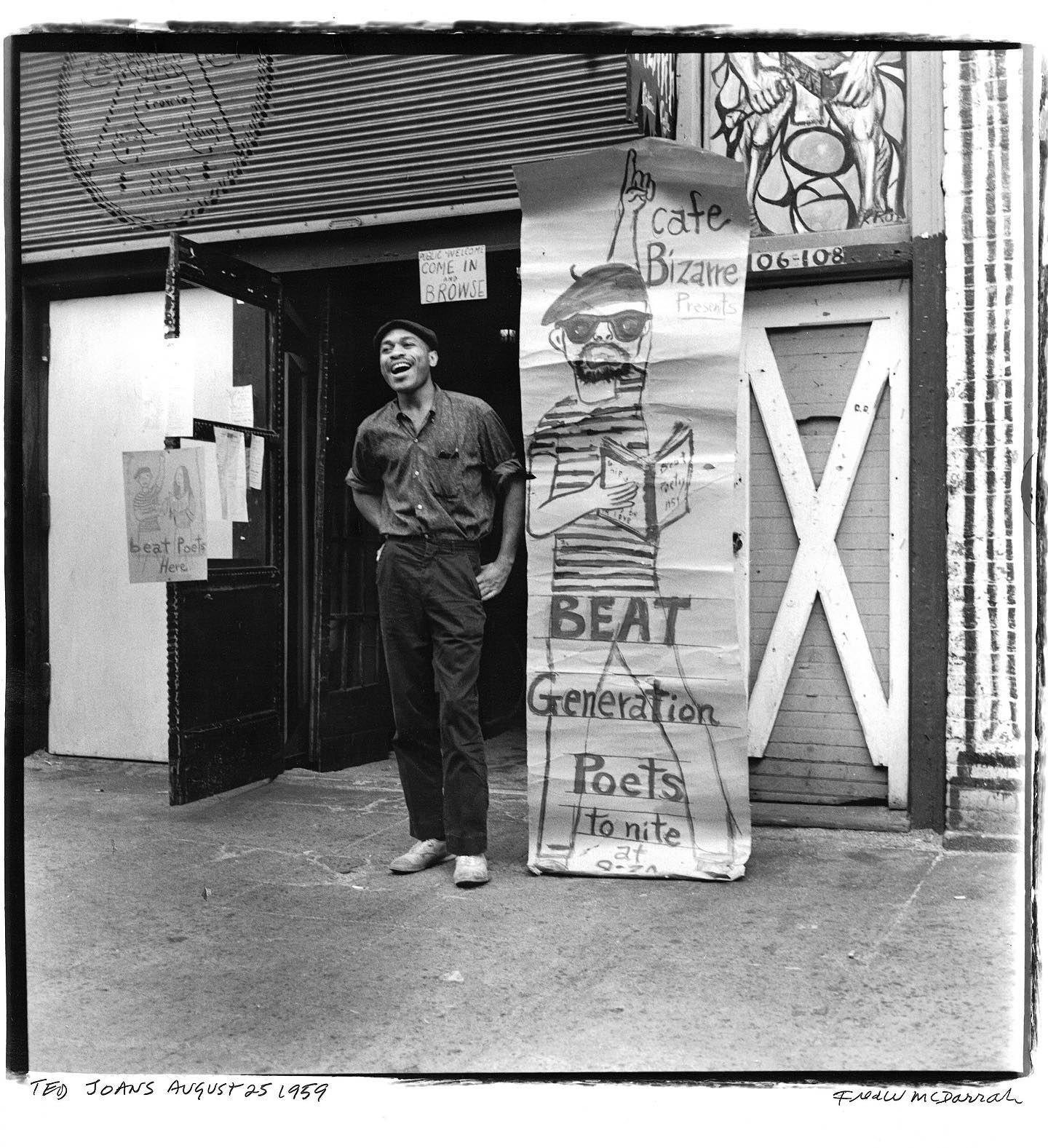 Now for part 3 of 3 in this week's series on Beat clubs of 1960s NYC 🌃   The first image is a portrait of American painter, poet, and musician Ted Joans (1928 - 2003) in front of Cafe Bizarre at 106 West 3rd Street, August 25th, 1959. He stands next to a poster that advertises 'Beat Generation Poets tonite'.  Cafe Bizarre was one of the more popular coffee houses and had a long history as a venue of music and culture. A jazz club before it was a Beat hangout, Cafe Bizarre was also where Andy Warhol first saw the Velvet Underground perform in 1965. The building was later torn down to make way for an NYU dorm building.  The second image shows American beat poet William Morris reading poetry on stage at the Cafe Caravan, May 24, 1959. This spot was known for its Sunday night poetry, with poets like Morris, Joans, and Hugh Romney (AKA Wavy Gravy).  © Fred W. McDarrah/MUUS Collection