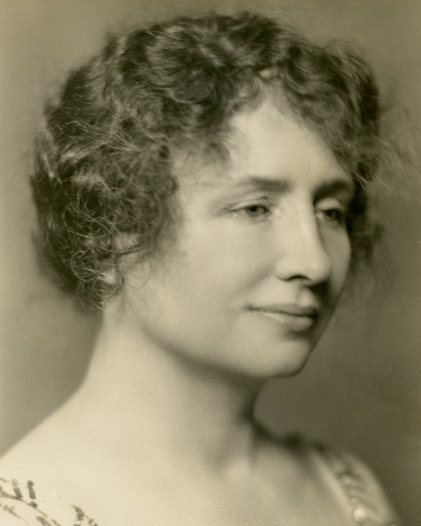 """⏳ """"Compiled in the 1920s and early 1930s by the Denver-based publisher James Alexander Semple, the """"Notable American Women"""" portfolio is an unvarnished time capsule of both celebrated and unsung women who made important contributions to American society and upon whose shoulders we all stand today."""" ⏳  Let Wendy Grossman (@wendy_grossman) introduce you to the Semple Portfolio of Notable Women in her essay """"On Their Shoulders"""". In it, she discusses the cultural and historical importance of Semple's unique project, as well as its faults along the lines of race and class.  Check out the link in our bio to read about the portfolio and the implications of who was and was not selected for inclusion in its vision of America's women.  Above is a portrait of Helen Keller softly smiling. She sent this image to Semple when he requested to include her in his portfolio.  © James A. Semple Portfolio/MUUS Collection"""