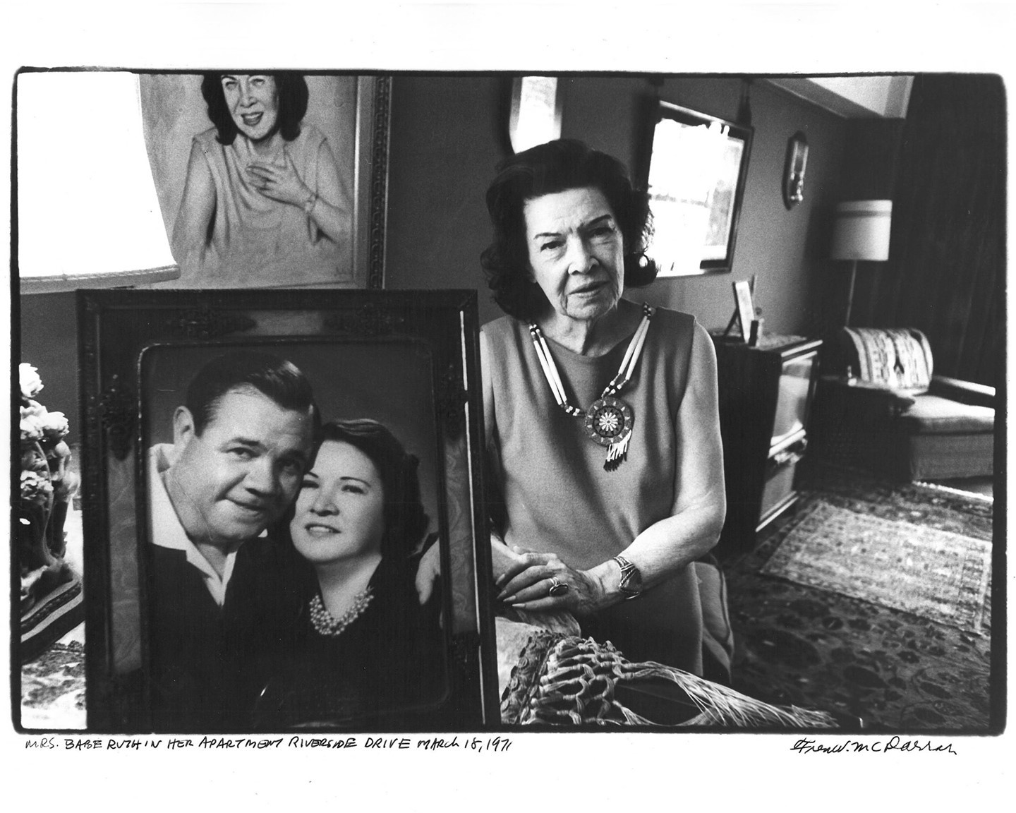 #OnThisDay in 1934, Babe Ruth played his last game of baseball for the New York Yankees.  Here, Claire Merritt Ruth poses in her apartment on Riverside Drive, behind a portrait of her and her late husband Babe. Taken in 1971 by Fred McDarrah.  © Fred W. McDarrah/MUUS Collection