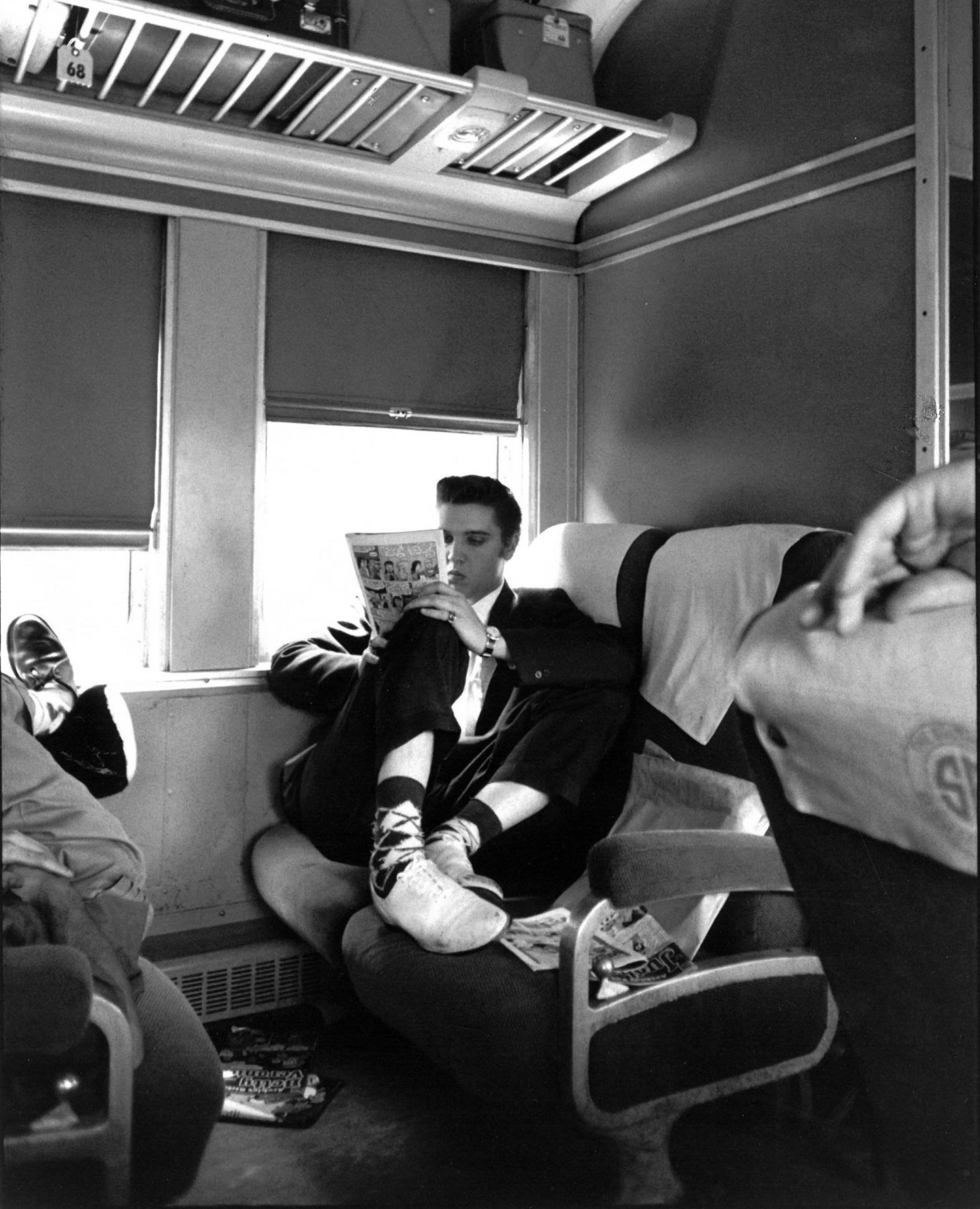 It's #NationalComicBookDay! Check out Elvis here, entertaining himself with a comic to pass the time on his train to Memphis.  © Alfred Wertheimer/MUUS Collection
