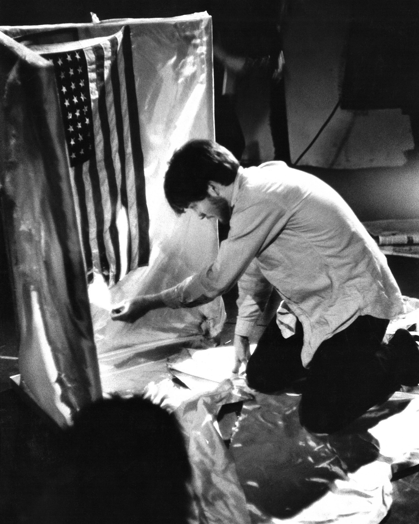 """Did you happen to catch the exhibition """"In Focus: Protest"""" at @GettyMuseum? If so, you might have seen this incendiary image of artist José Rodríguez-Soltero burning an American flag in his 1966 performance protesting the Vietnam War.  This photo was captured by our own Fred McDarrah, whose body of work holds a wealth of protest imagery - from early Pride marches to the infamous 1969 DNC protest to massive anti-nuclear arms rallies. He also closely associated with some of the most revolutionary artists, writers, and musicians of the 1960s - so this image represents a natural intersection of McDarrah's interests as a photographer.  To learn more about McDarrah and his work as a staff photographer at the Village Voice, check out the link in our bio! And be sure to stay tuned for more iconic images 📸  © Fred W. McDarrah/MUUS Collection"""