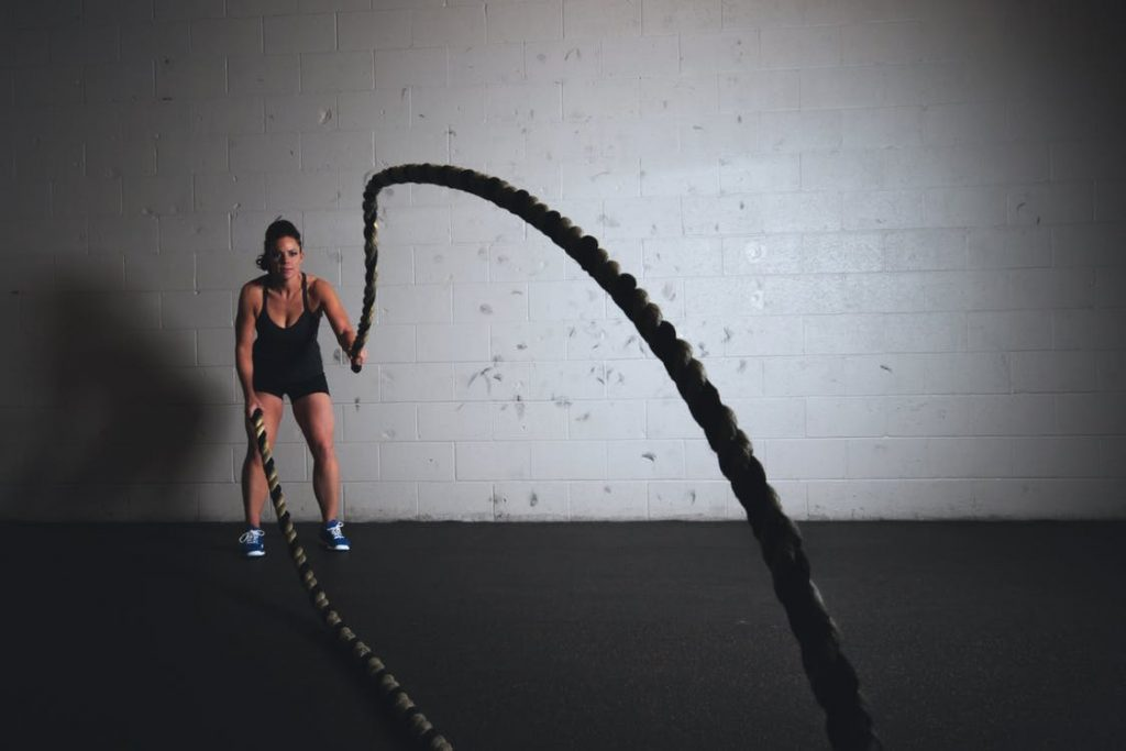 Facebook ads for chiropractic leads woman with ropes