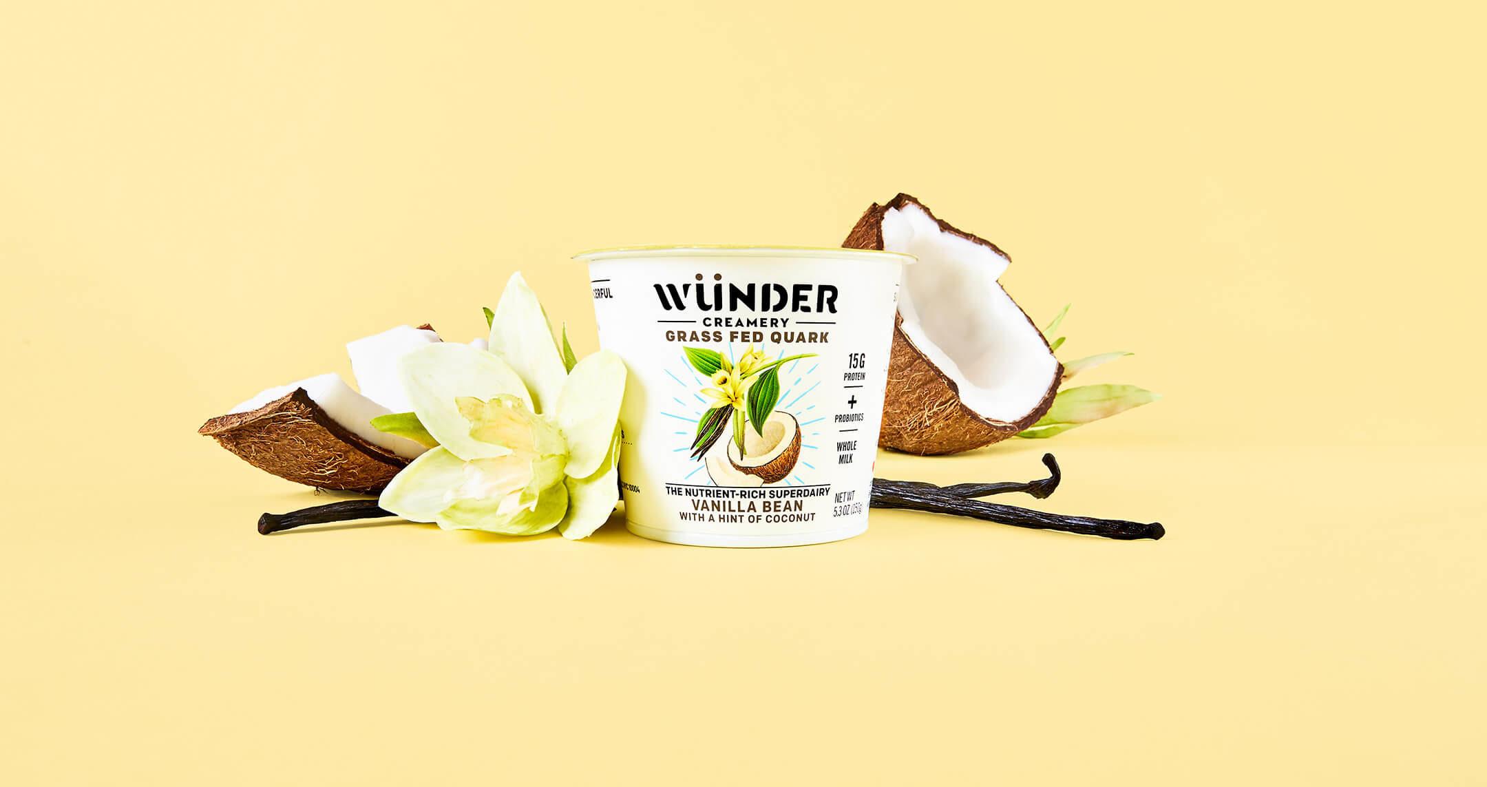wunder creamery vanilla yogurt container with coconuts surrounding it