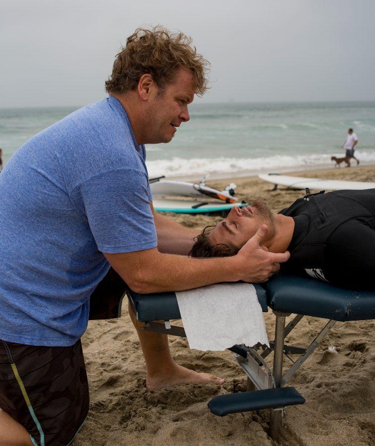 Dr. Glow adjusting a patient's neck'