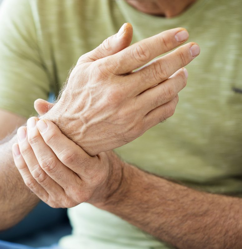 a man holding his wrist in pain