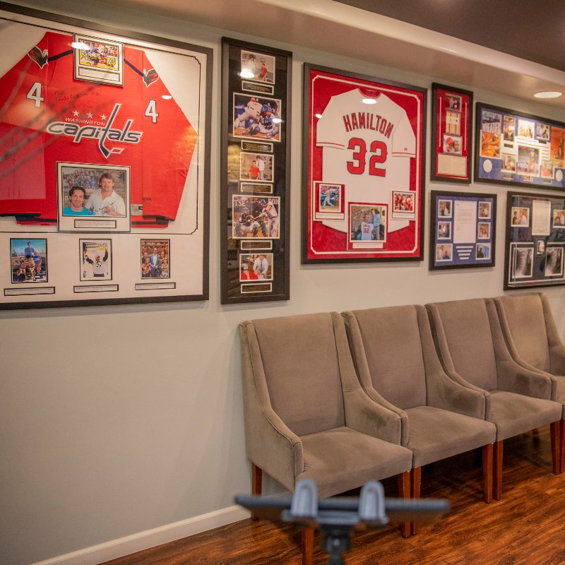 a wall of all of Dr. Glow's sport clients