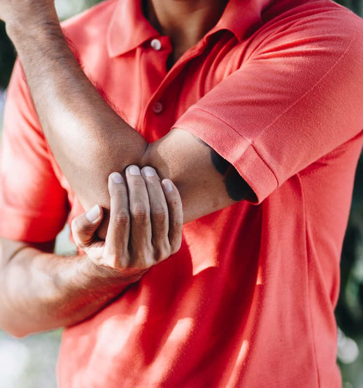 a man holding his elbow in pain